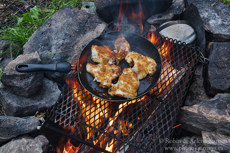 Walleye in frying pan over fire